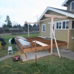 Putting on 2 x 6 treated decking