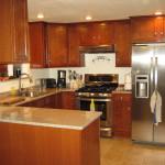 Recessed lighting, quartz countertops and Aristokraft cabinets
