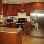 Completely functional, modern kitchen with stainless steel appliances, quartz countertops and cabinetry