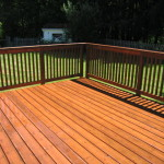 Finished deck overlooking the lawn on a beautiful, sunny day