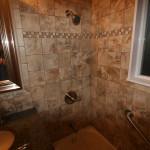 New shower valve, tile, PVC trim around window (waterproof) and grab bars