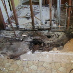 The floor was damaged for four feet in either direction from the wall into two rooms, requiring we rebuild both the bathroom and the laundry room.