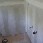 Replaced the floor and the walls in the bathroom
