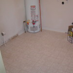 Finished laundry room, new floor. walls and hot water heater