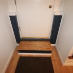 Exterior door, custom oak step, bead board and trim.